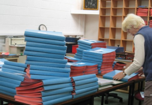 Volunteer labelling Braille Bibles
